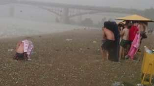 Hail Storm Hits Beach After Heatwave