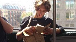 'Hot Dudes Reading' is What You Need on Your Commute