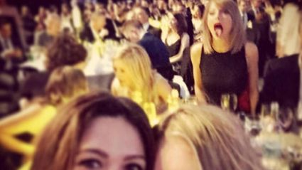 Taylor Swift Photobombs Fans at the BRIT Awards In Hilarious Pic