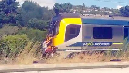 Two Men Seen Train Surfing