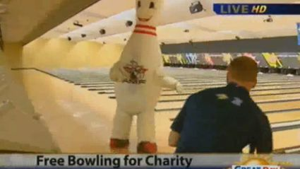 Reporter Gets Chased By Massive Bowling Pin Who Then Falls Over