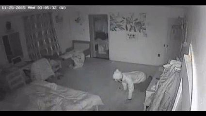 Watch the Terrifying Moment An Armed Burgler Crawls Into A Sleeping Family's Bedroom