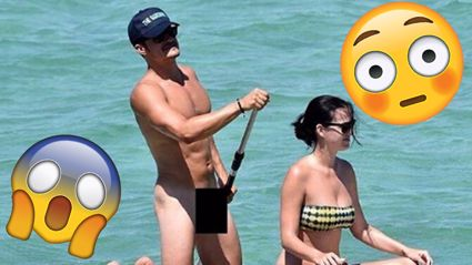 Orlando Bloom's friends posed in front of his nude paddle board pic at the his 40th