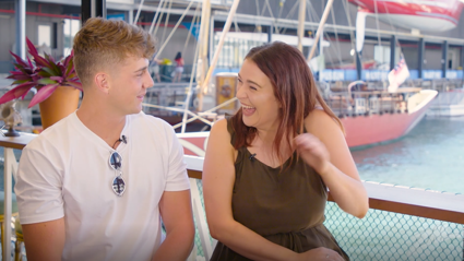 Watch Producer Caitlin and Harry Jowsey flirt with the Heartbreak Island girls