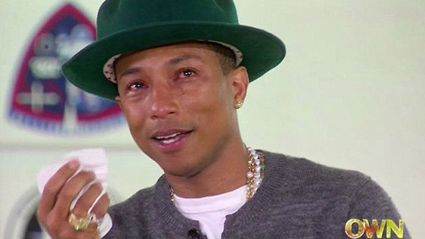 "Pharrell Bursts Into Tears Watching ""Happy"" Videos"
